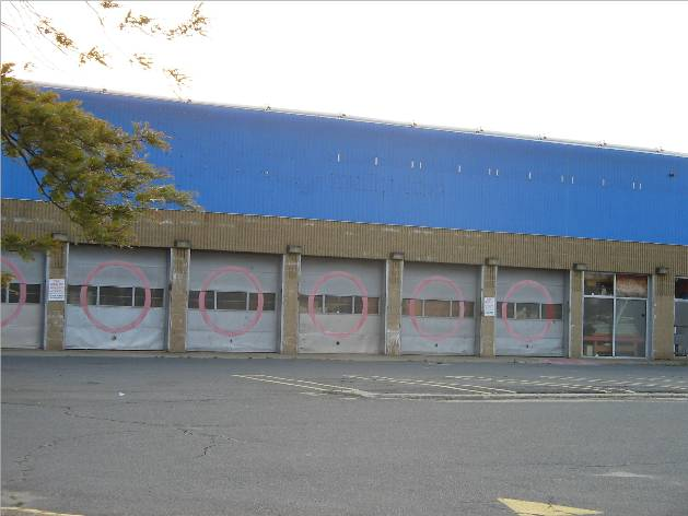 Former Speedy Muffler and Kmart Auto Center at Mystic Mall in Chelsea, MA