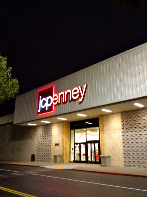 JCPenney at Serramonte; notice the climbable rock formations on the wall. When I approached, he smiled to me and declared, 'Rock climbing!'